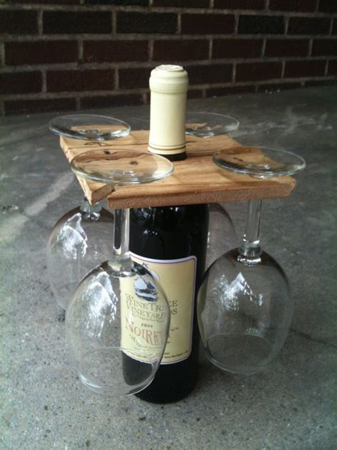 What Is A Good Housewarming Gift party of four hardwood rack for wine bottle and four glasses