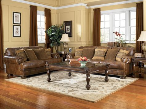 leather living room furniture ashley furniture ralston teak living room set 91500
