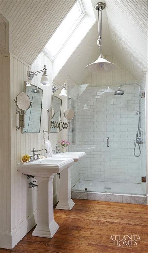 Vaulted ceiling bathroom with pendant light overhead sconces