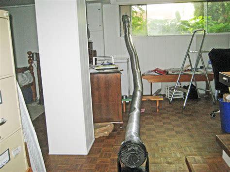 How do I install an exhaust fan in a basement?