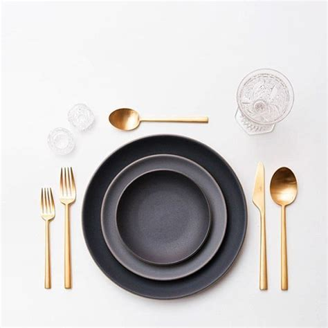 table cutlery set up unusal table setting with golden cutlery black grey