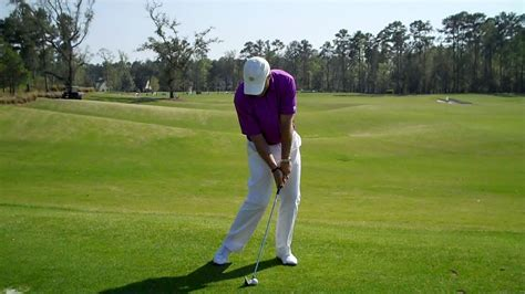 swing the clubhead golf hands forward at impact