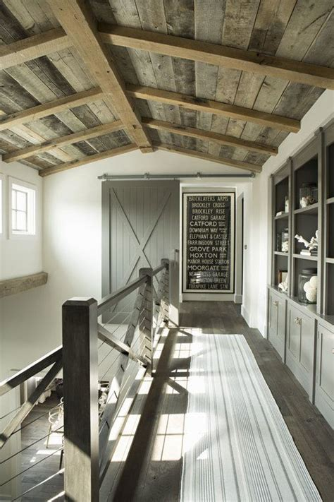 hanging barn door from ceiling barn door to the bedrooms hanging the wall is this
