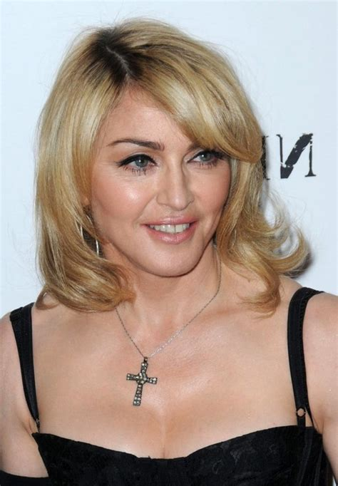 bob hair cut over 50 back madonna blonde wavy bob hairstyle for women over 50