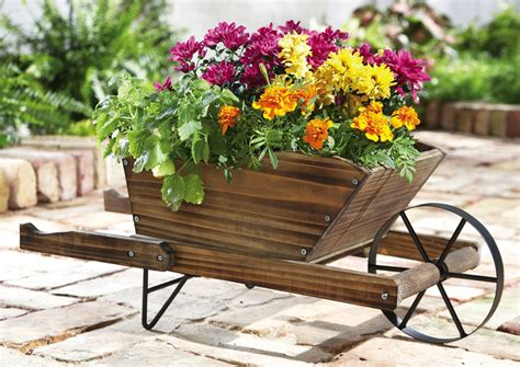 Wheelbarrow Planter Ideas by 25 Wheelbarrow Planter Ideas For Your Garden Garden