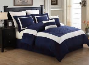 12 luke navy and white embroidered bed in a