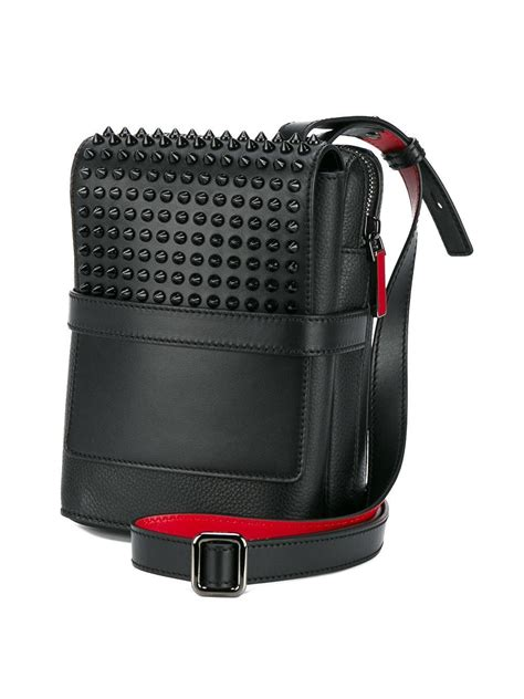 christian louboutin spiked reporter bag in black for lyst