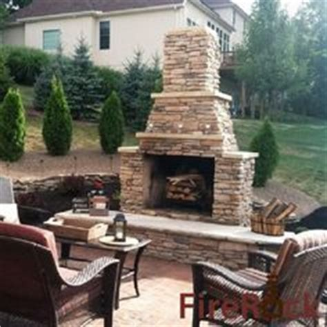 Outdoor Fireplace Stacked Tempting And Brick Outdoor Fireplace Built Into Retaining Wall The Dry