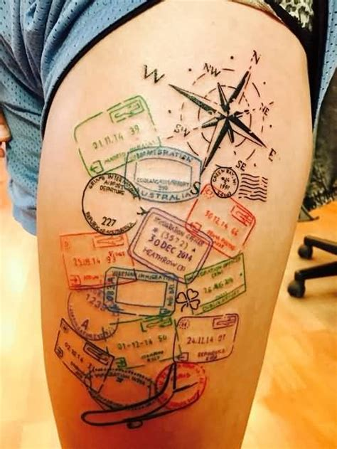 passport visa stamps compass tattoo on side thigh