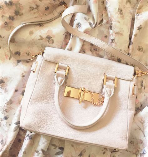 Lc Bag 19022 3 lc conrad runway collection leather cross bag complete with gold hardware