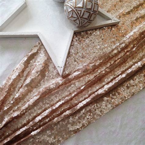 chagne blush sequin table runner by the sweet