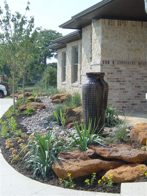 custom landscape design flowermound texas small boulders