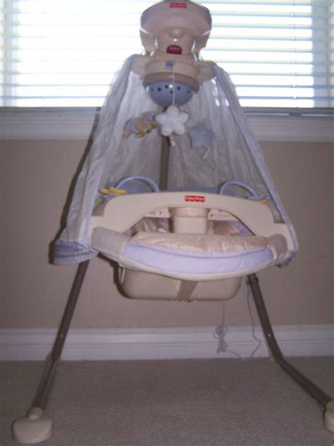 fisher price starlight cradle baby swing fisher price papasan cradle swing in starlight purple