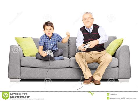 video game couch senior man sitting on a couch and playing video games with