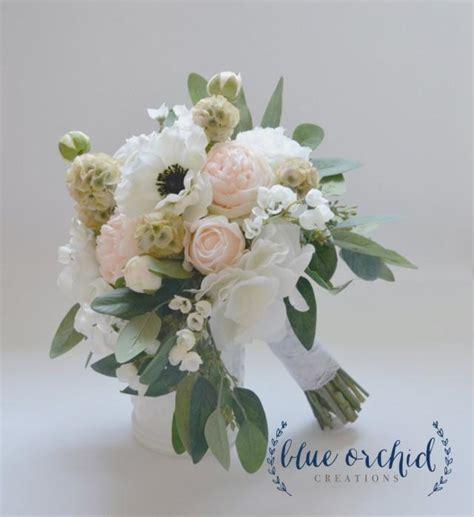 blush wedding bouquet anemone peonies ranunculus