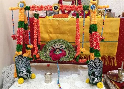 Home Decoration For Janmashtami by Decorate Krishna Jhula With Rakhi Cover The Frame With Colorful Rakhis And Place Lord Krishna