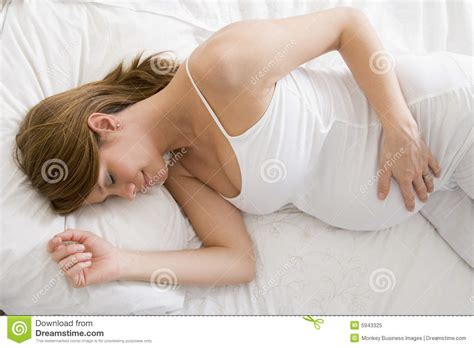 girl lying in bed pregnant woman lying in bed sleeping royalty free stock