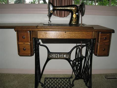 antique singer sewing machine with oak cabinet by