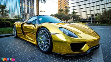 porsche supercar 918 porsche 918 spyder wears traditional supercar gold chrome