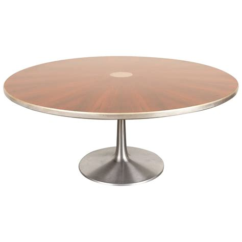 rosewood dining table with pedestal base by poul