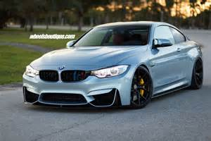 bmw m4 tries on matte black wheels on a lowered