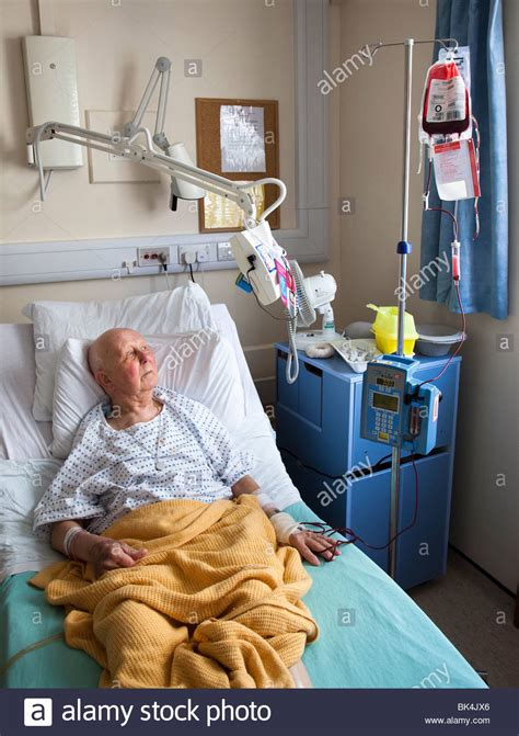 swing bed hospital patient in hospital bed watching television on swing arm