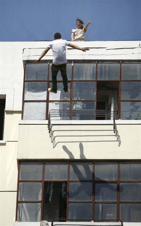 back tattoo man jumping off building jumping off building suicide www imgkid com the image