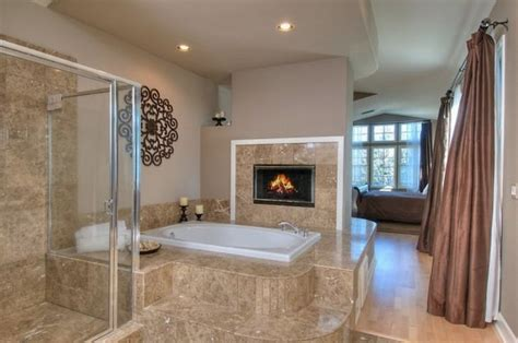 trendy custom bathrooms with fireplaces for a