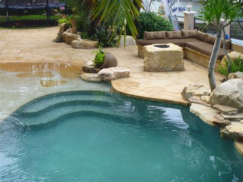 Outdoor Kitchens Florida - masonry and stone work boulder fire pit pool patios tropical pool other metro by