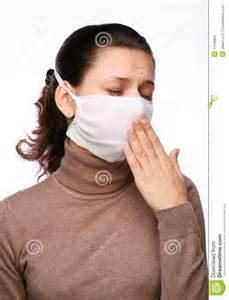 Coughing woman in a medical mask royalty free stock image image