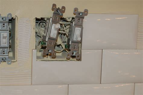 how to cut glass tile backsplash around outlets home how to install backsplash around outlets