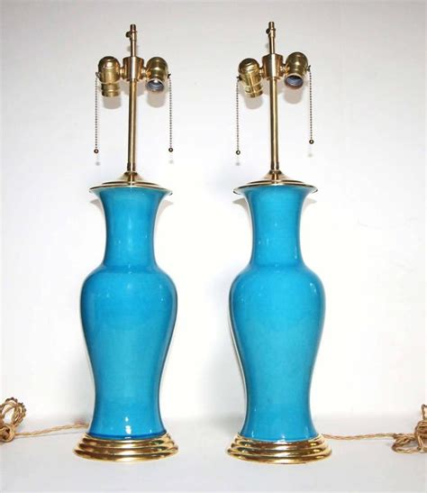 pair of turquoise blue ceramic ls with water gilt wood