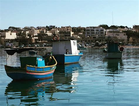 fishing boat bobbing sea fishing boats bobbing in marsaxlokk photo