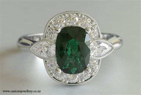 emerald cushion cut and pear cluster dress ring