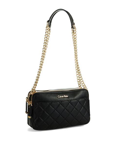 calvin klein quilted crossbody bag in black lyst