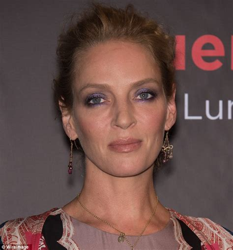 43 years old actress uma thurman dazzles in a floor length gown as she presents