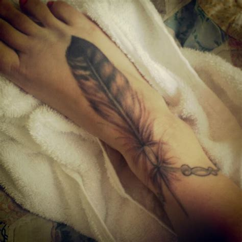 feather tattoo on your foot eagle feather tattoo on foot