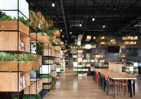 Recycled steel bars form modular caf 233 interior by penda