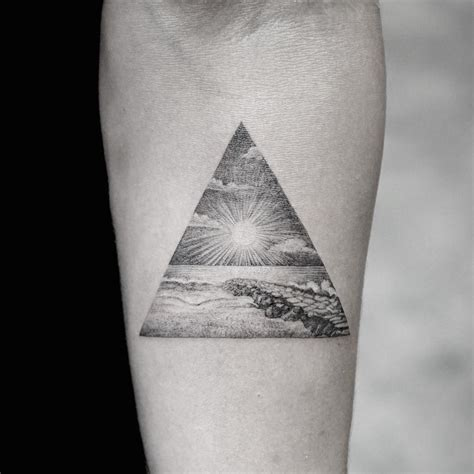 nature tattoo with sea and sun