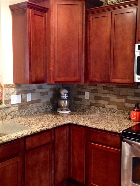 cherry kitchen cabinets with granite countertops airstone backsplash in kitchen quot autumn mountain quot maple