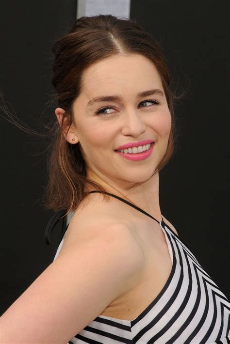 emilia clarke shows skin in a striped dress at the