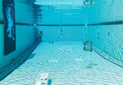 designboom underwater underwater art show is submerged in a swimming pool in la