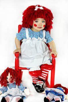 woman swings baby like a rag doll yarn babies rag doll girl toddler child costume rag