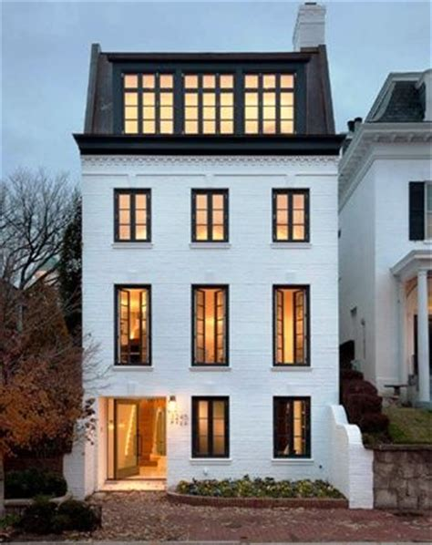 white house with black windows georgetown townhouse curb appeal with painted white brick