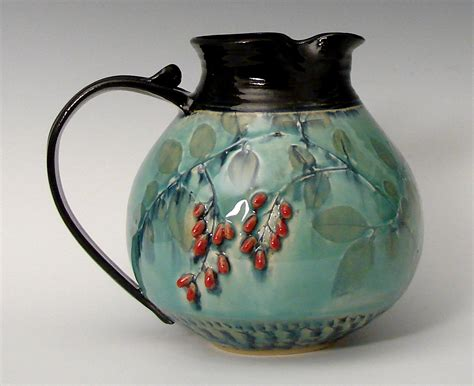 images of pottery chubby pitcher with red berries by suzanne crane ceramic