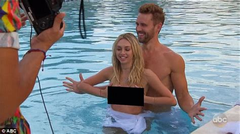 The bachelor corinne olympios takes off bikini top during group date