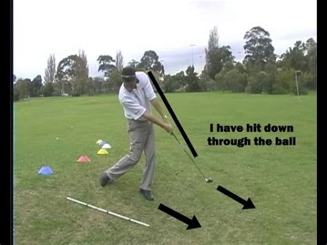 how to swing down on the golf ball golf swing tips golf lessons melbourne hit down through