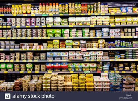 Shelf Food by Shelf With Food In A Supermarket Milk Products Butter