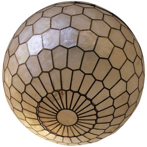 capiz shell globe light stunning capiz shell and brass globe chandelier at 1stdibs