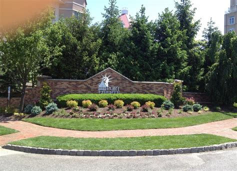 Landscape Design Around Signs Commercial Landscape Maintenance At Porte Liberte